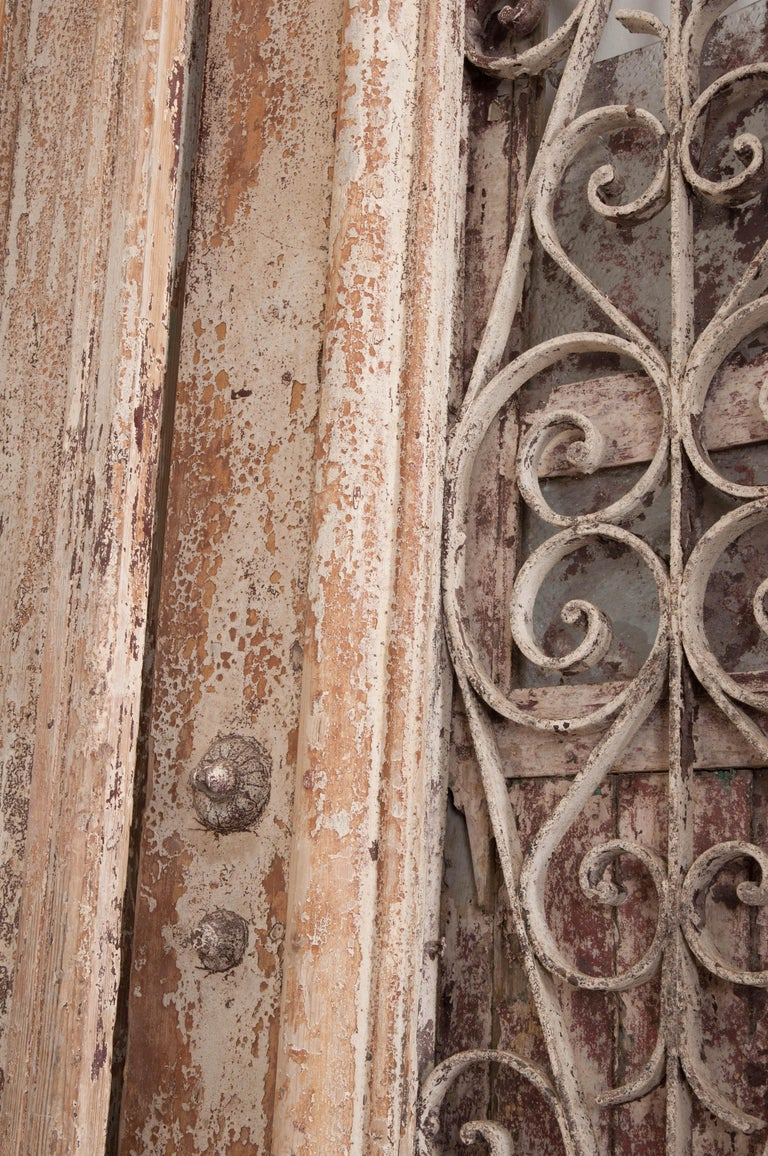 Carved Tall Pair of Napoleon III-Style Painted Pine and Wrought-Iron Entrance Doors For Sale