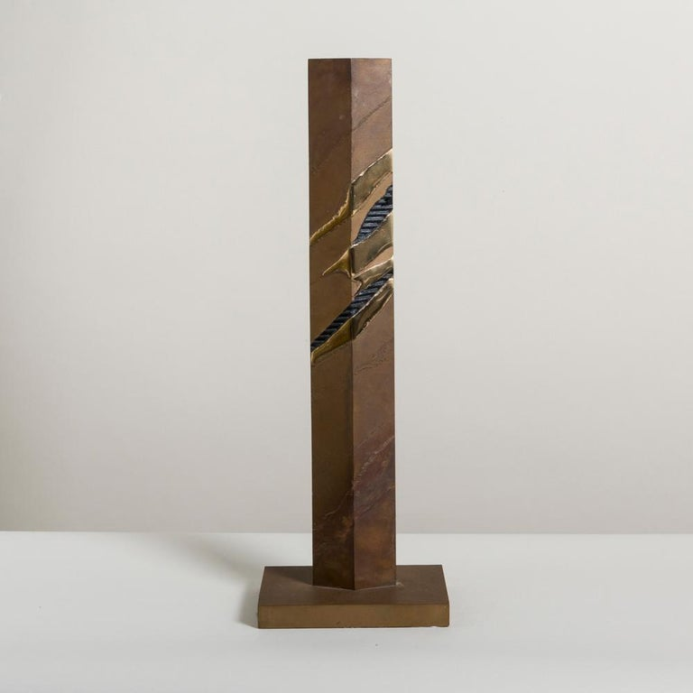 A tall patinated steel sandstorm inspired table sculpture with polished brass accents, 1980s
