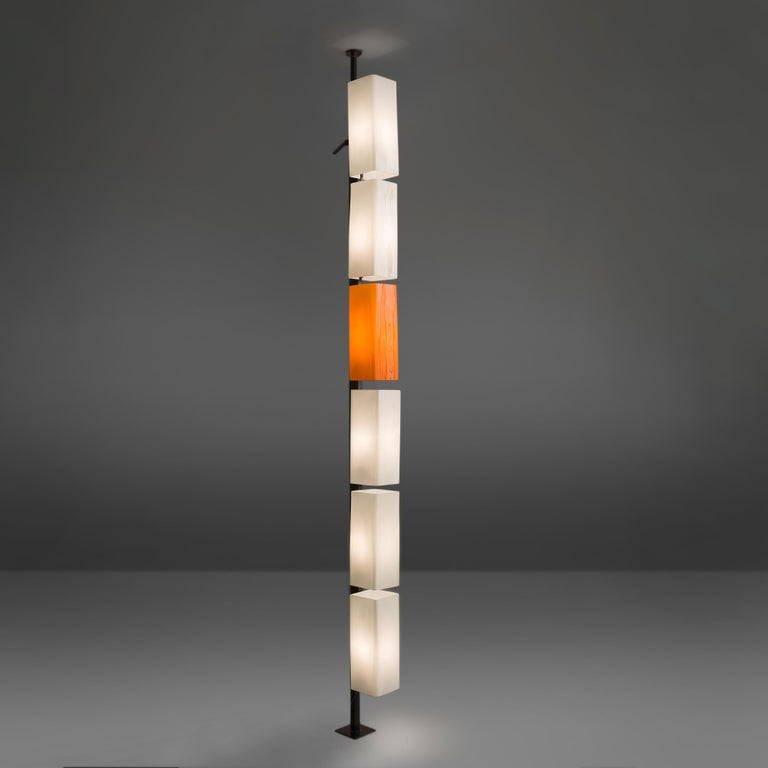 Floor lamp, orange and white glass, Italy, 1960s.   This rare and unique floor lamp is typical for the Postmodern design of the 1970s in Italy. The different glass lamp shades are placed above one another and form a simplistic yet playful whole