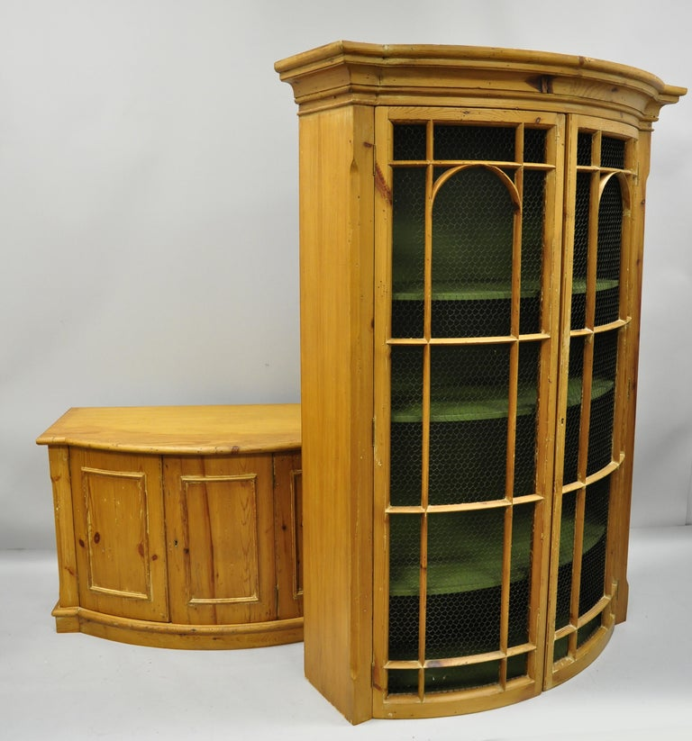 Tall Spanish bookcase cabinet. Item features green painted interior, two swing doors with metal wire lattice, and lower swing cabinet doors, circa mid-20th century. Measurements: 87