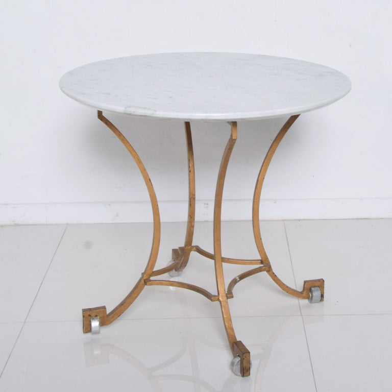 Midcentury 1960s Mexico by Talleres Chacon attributed to Arturo Pani: Round side table scalloped flaired iron frame with gold gilt, new marble top beveled edge and standout silver aluminum fancy feet. Exceptional geometric angled design. No label