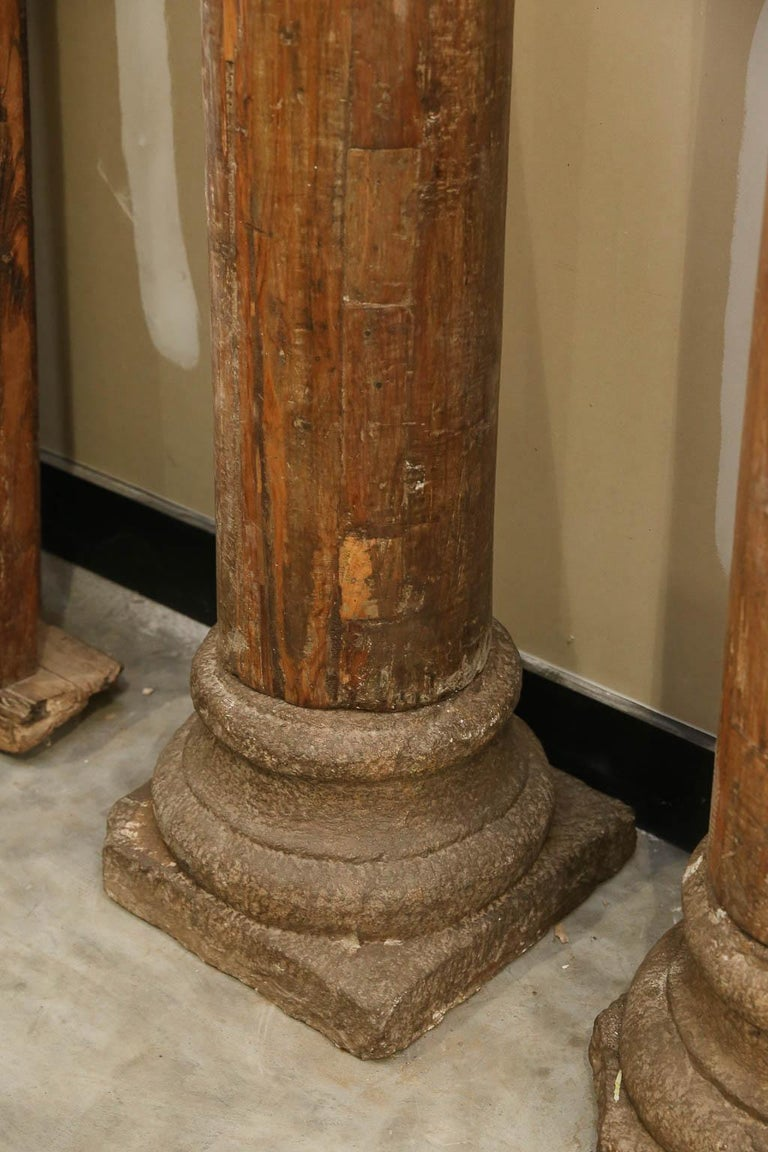 These are museum quality mid-19th century load bearing columns from a central Indian luxury settlet's home. Tallest vintage wooden columns that can be found in the market. How these columns were made to such great degree of perfection when wood