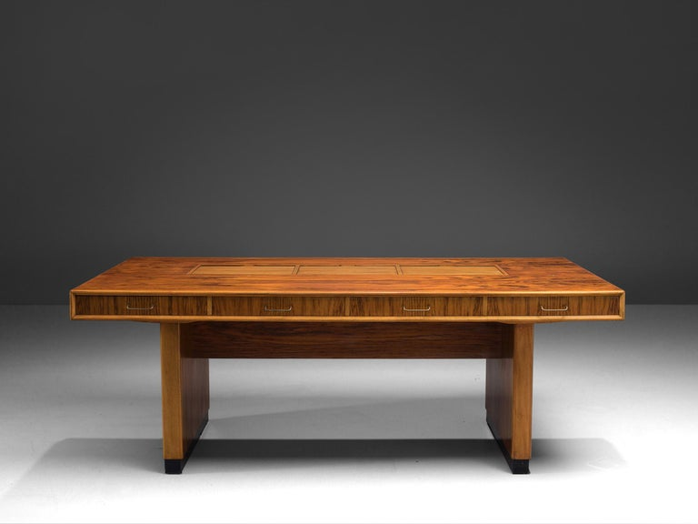 Desk, rosewood and walnut, the Netherlands, 1960s.  This classic, architectural piece is executed with three storage spaces on the top of the desk and on both sides. The piece stands out thanks to the use of various types of wood such as walnut and