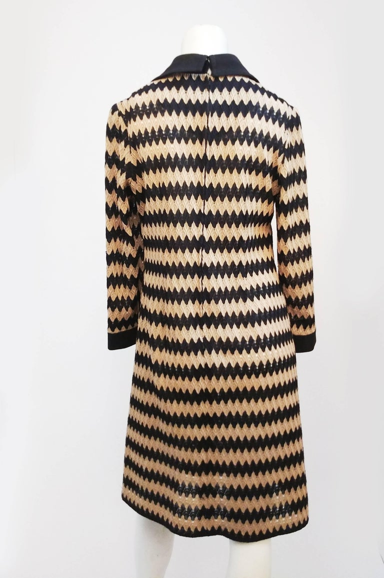 Tan and Black Knit Zig-Zag Collared Dress, 1970s. Long sleeve knit dress with contrast zigzag pattern, large 1970s collar, and matching cuffs at wrists.