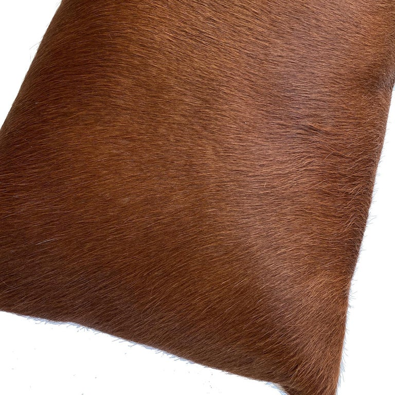 Create an atmosphere of style with this striking cowhide lumbar pillow. Whether layering with other cushions or styled on its own the tan cowhide pillow will help transform rooms in an instant.  Each cowhide cushion is individually handcrafted in