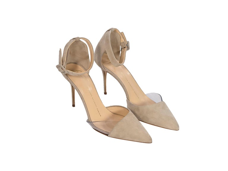 Product details:  Tan suede pumps by Giuseppe Zanotti.  Adjustable ankle strap.  Point toe with clear trim.  3.5