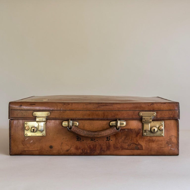 A fine Brachers of Bristol and Cardiff suitcase circa 1900 in veg-tanned, heavy-gauge, hand-stitched cow-hide.  This is a good example of their superb luggage, the best of British craftsmanship. The case has been well used and has developed a lovely