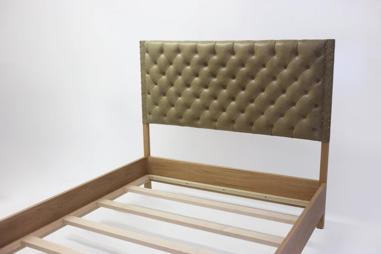 The Belfort Bed, part of the LF Collection, shown made with oak frame with stunning grain details - the headboard and base is all handcrafted with tufting and self covered buttons in the tufts and along the edge. Can be made custom as well as have a