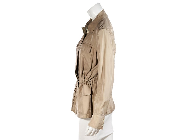 Product details:  Tan cotton/silk-blend windbreaker jacket by Loro Piana.  Spread collar.  Long sleeves.  Two-button detail at cuffs.  Concealed zip-front closure.  Front patch pockets.  Drawstring waist.  Label size IT 44.  40