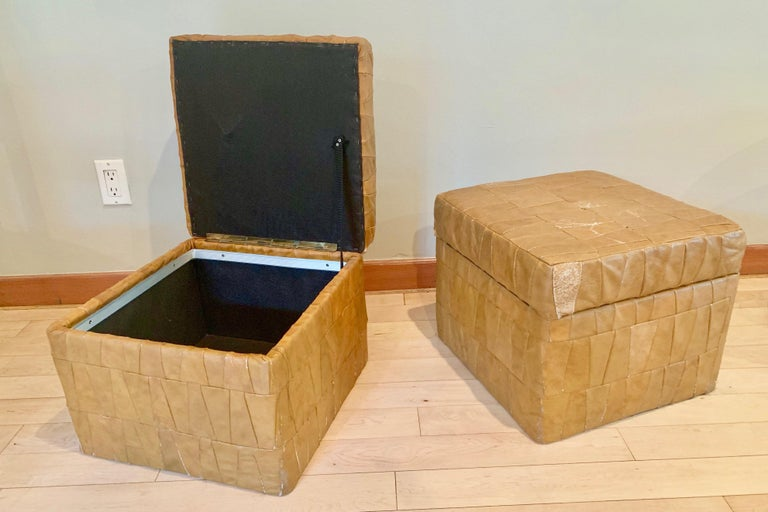 Patchwork leather ottomans by De Sede in tan. Ottoman has storage inside. Good condition. Some wear to leather. See photos. Great accent pieces and nice scale.
