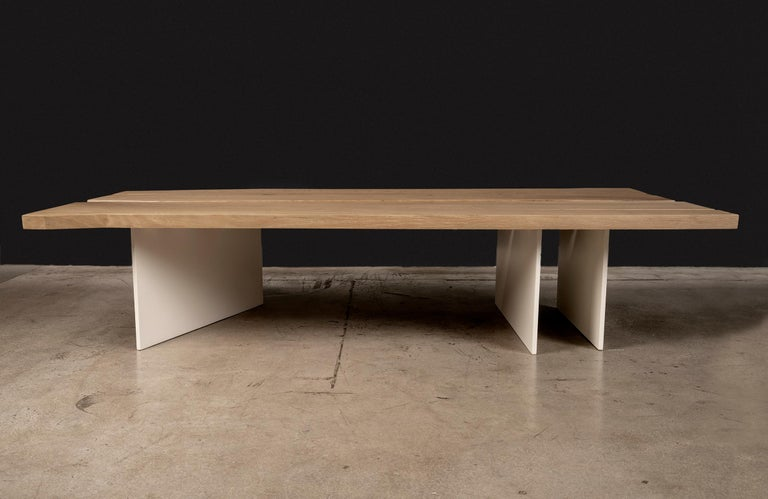 The Tandem coffee table was inspired by the pureness of the natural white oak slabs. The slabs were cut and angled along their natural edge to create a more contemporary feel without losing the sense of its raw origin. The two slabs are attached