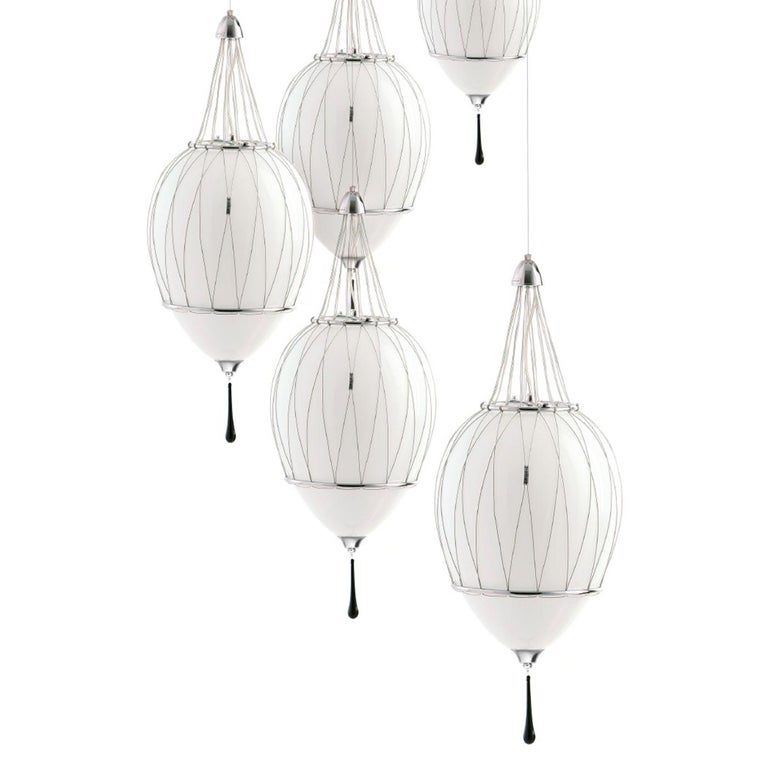 Inspired by Art Deco style, this superb pendant lamp features an alluring design that blends classic elegance with a modern allure that will enrich any interior with luxury. This exclusive piece from the Tango Collection boasts an egg-shaped shade