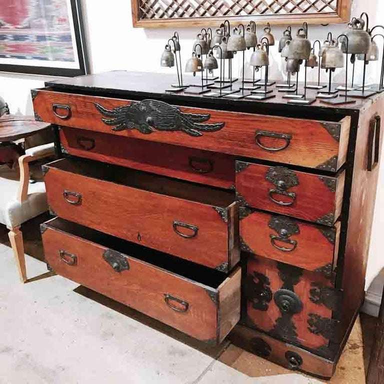 A stunning Tansu chest from Japan, Edo period, mid-18th century. Rustic Cedar in red finish. Delicately carved bronze trimmings, handles and decoration. Six drawers, plus a secret cabinet compartment with four small drawers behind a keyed door. Very