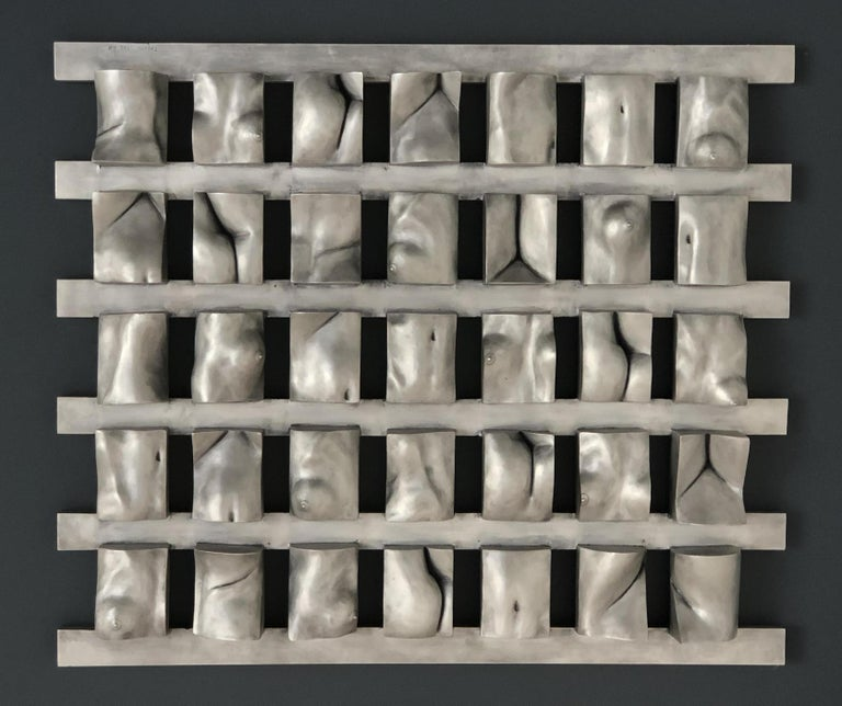 This aluminum wall-mounted sculpture brings together thirty five individually sculpted and cast figurative elements that are then welded to extruded aluminum bars. Produced in a limited edition of 3.  Dimensions: 25 x 29 inches  If you are