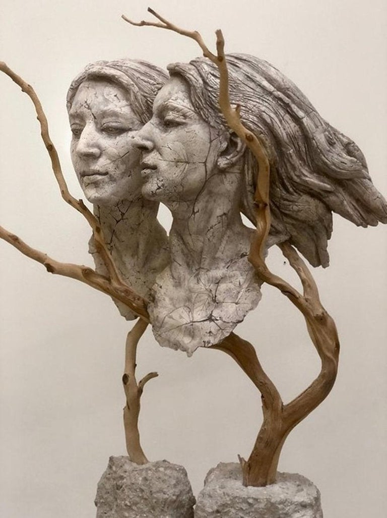Muse  2017  Ceramic clay, found wood, concrete, India ink, underglaze, birch and sycamore leaves, raw pigments  Measurements: 28.75 x 25 x 9 inches  Hard Wisdom which has her reflecting, as she ages, on her experiences of birth, loss, and