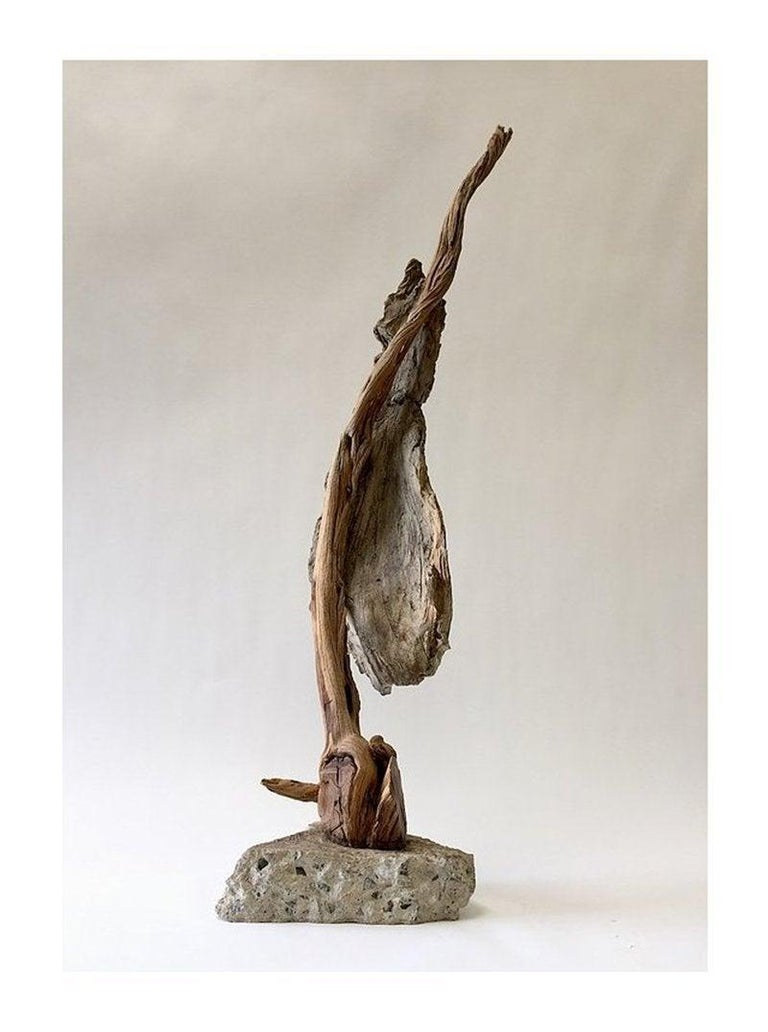 Ceramic clay, found wood, concrete, India ink, underglaze, birch leaves, raw pigments  One of a kind sculpture. Measurements: 48.5 x 15.5 x 10 inches  Hard wisdom which has her reflecting, as she ages, on her experiences of birth, loss, and