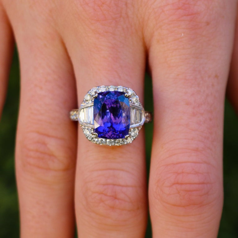 Tanzanite = 6.88 carats Diamonds = 1.2 carats ( Color: F, Clarity: VS ) 18K White Gold Ring Size = 6 Complimentary Ring Sizing Available Jewelry Gift Box Included