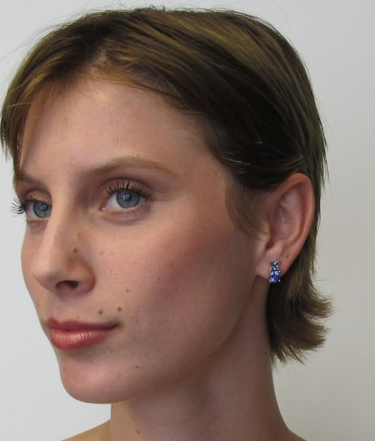 These drop earrings convey a simple sophistication. With the color blocking effect between the two tanzanite stones, 2.38 carats total, and the two aquamarines, .68 carats total, add a unique twist to a classic design. Handmade by our master
