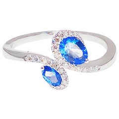 Tanzanite and Diamond Asymmetric Ring, 14 Karat White Gold 1 Carat Tanzanite