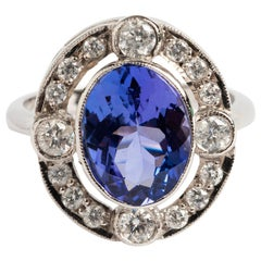 Tanzanite (est8.5 carat) & Diamond Cluster Ring (est1.00 carat). 18K White Gold.