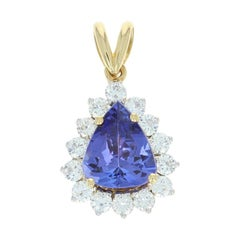 Tanzanite and Diamond Halo Pendant, 18 Karat Gold Pear Brilliant 4.20 Carat