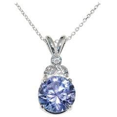 Tanzanite and Diamond Pendant in 14 Karat White Gold