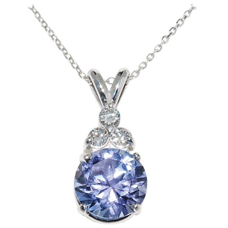 6709fb17652a1 Tanzanite and Diamond Pendant in 14 Karat White Gold