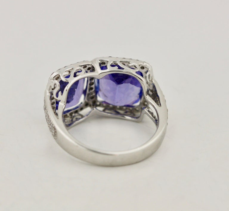 Tanzanite and Diamond Ring  with twin rectangular cut tanzanites weighing approximately 7.05 carats together, within a pavé-set frame of round diamonds weighing approximately .60 carats, mounted in 18 kt white gold  8.29 grams (gross), size 6 1/2