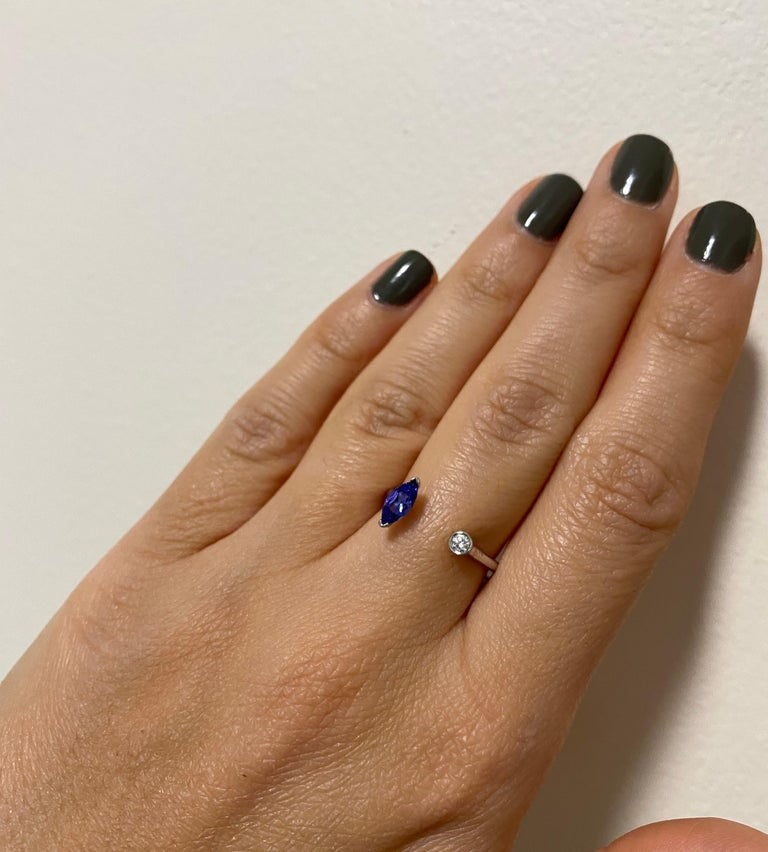 Material: 14K White Gold Stone Details: 1 Marquise shaped Tanzanite at 0.31 Carats - Measuring 6.6 x 3.2mm Diamond Details: 1 Brilliant Round White Diamond at 0.05 Carats Alberto offers complimentary sizing on all rings.  Fine one-of-a-kind