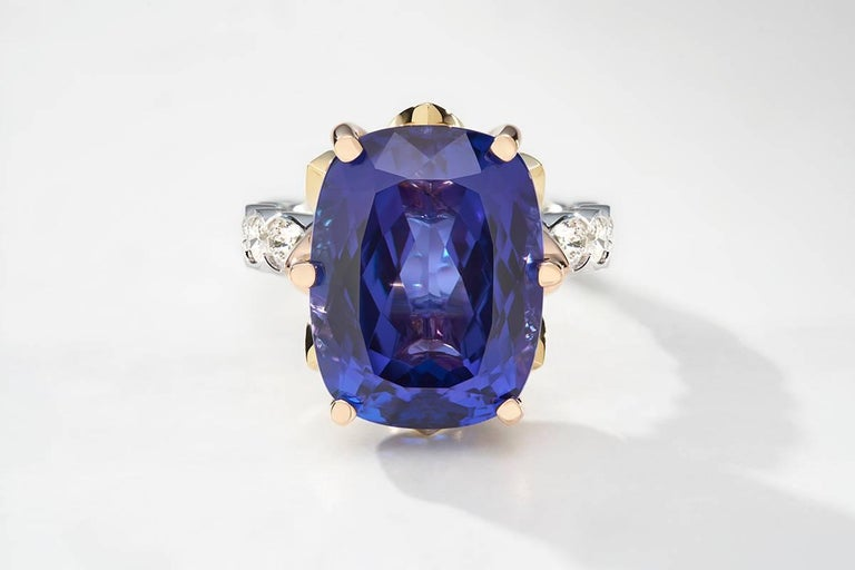 Blossom Collection, Tanzanite and Diamond Ring. The Blossom Collection coloured gemstones are a uniquely designed cut of an oval cushion cut top with a high crown to emulate an antique Georgian style with a brilliant cut base to maximise the