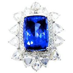 Tanzanite Cocktial Ring in 18 Karat Gold Nested in an Oval Crown of Diamonds