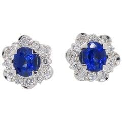 Tanzanite and Diamond Halo Stud Earrings in 18 Karat White Gold