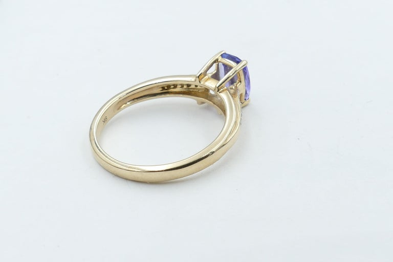 Cushion Cut Tanzanite and Diamond Modern or Dress Ring Set in Yellow and White Gold For Sale