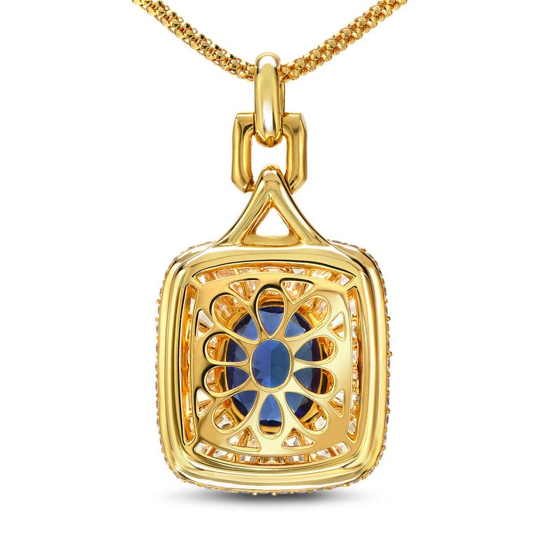 Tanzanite diamond pendant necklace featuring a vivid blue 3.67 carat oval Tanzanite, and 4.57 carat custom-cut to fit, baguette and round brilliant diamonds. Crafted by extremely skilled hands in 18K yellow gold. Necklace length is 18