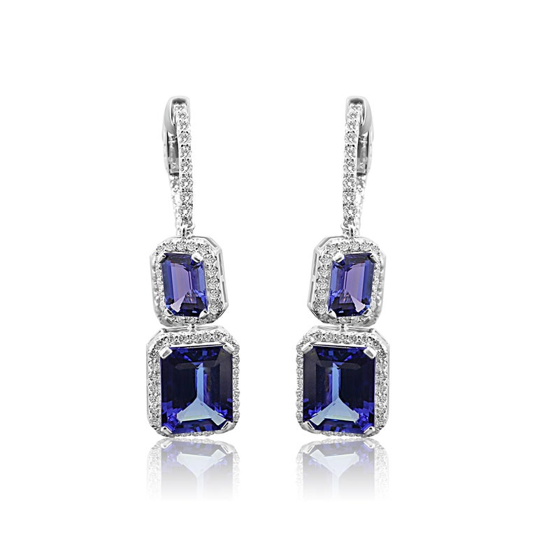 Stunning 2 Emerald cut Tanzanites 6.15 Carat with 4 smaller Tanazanites 4.47 Carat set in Halo White G-H color VS-SI Diamond Rounds 1.65 Carat set in Gorgeous Halo style Dangle Drop Earring in 14K White Gold.  Style available in different price