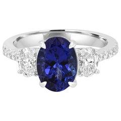 Tanzanite Oval 2.44 Carat Diamond Three-Stone Bridal Cocktail Gold Ring