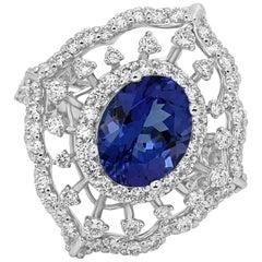 Tanzanite Oval 2.75 Carat Diamond Triple Halo White Gold Cocktail Fashion Ring