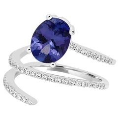 Tanzanite Oval and Diamond Gold Spiral Cocktail Fashion Ring
