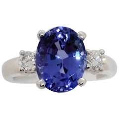 Tanzanite Oval and White Diamond Round 3-Stone Ring in Platinum