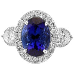 Tanzanite Oval Diamond Halo Three-Stone Fashion Cocktail Two-Color Gold Ring