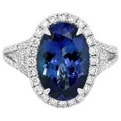Tanzanite Oval Diamond Round Halo Gold Bridal Fashion Ring