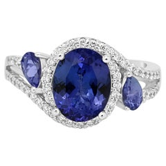 Tanzanite Oval Diamond Three-Stone Gold Halo Ring