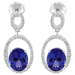 Tanzanite Ovals 6.02 Carat White Diamond Rounds Halo Gold Drop Dangle Earrings