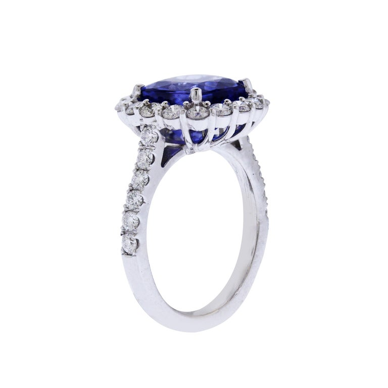18K White Gold and Diamond Ring with Tanzanite center  Tanzanite is truly incredible quality with vibrant color and clarity. Apprx. 4.50 carat  1.20 carat G color, VS clarity white diamonds are set on the band and surrounding the Tanzanite  0.5 inch