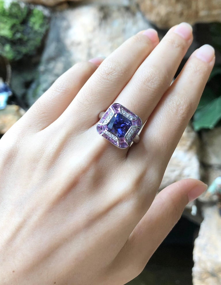 Tanzanite 3.36 carats with Pink sapphire 2.61 carats and Diamond 0.14 carat Ring set in 18 Karat White Gold Settings  Width:  1.6 cm  Length:  1.6 cm Ring Size: 53 Total Weight: 10.61 grams