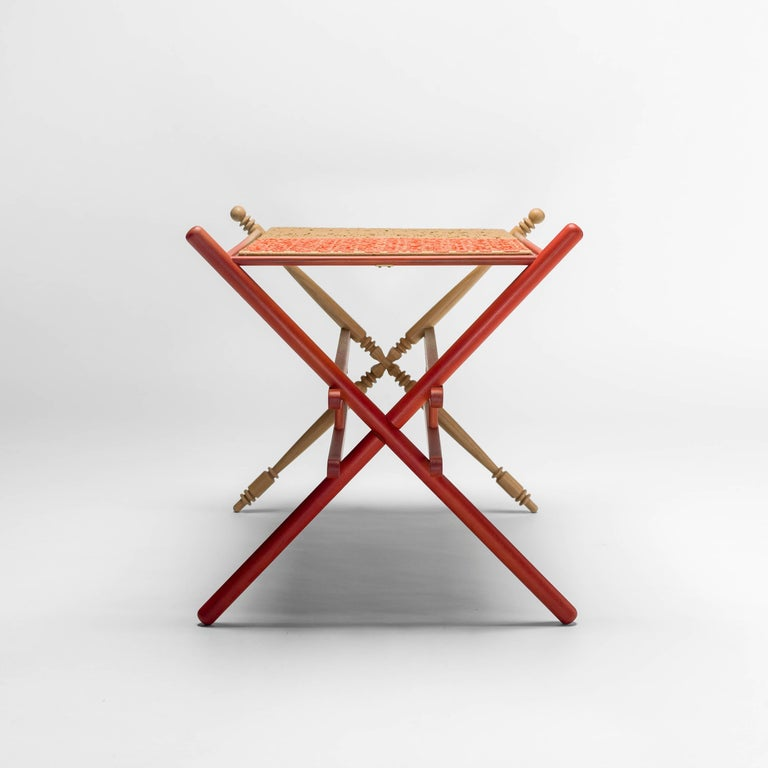 Solid oak structure with degraded red finish and tray made with craft paper and red textile ribbon.  Limited Edition of eight units and two artist proofs and two prototypes.  Measures: 88 x 63 x 62 H cm.  Available now, this piece was placed