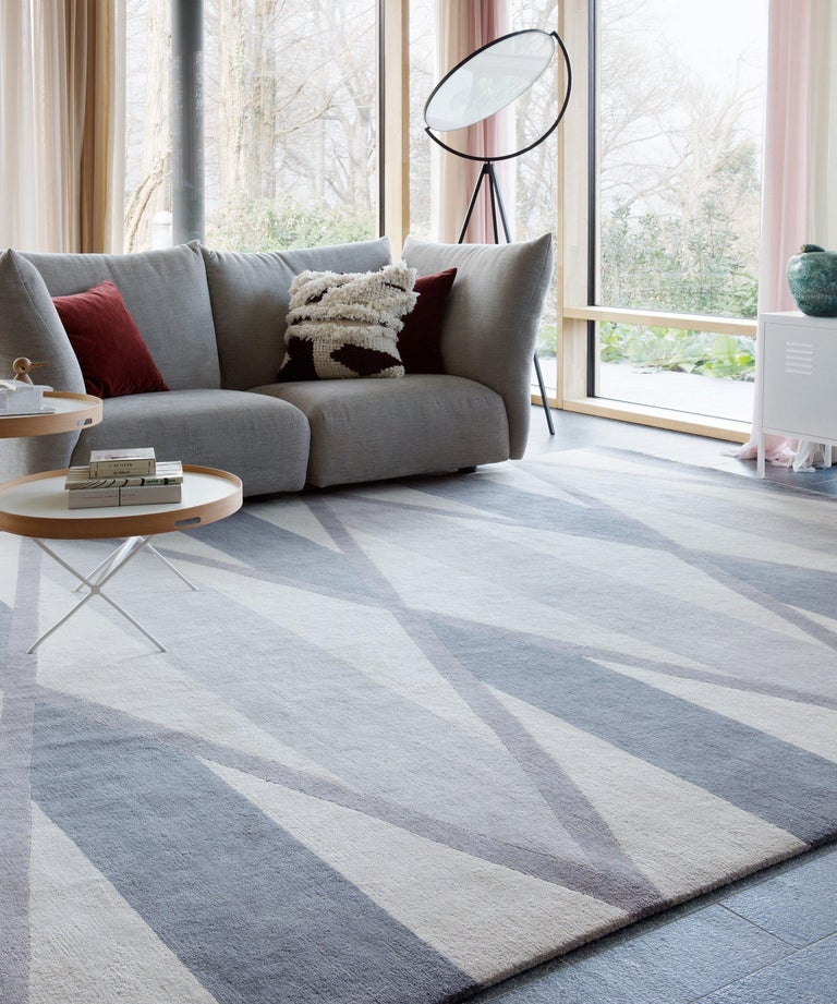 Based on an American quilt pattern and composed of a pared-back palette of muted grey and cream, Taos combines diamonds and lines in perfect proportion to create a mirrored effect. Hand-knotted in the finest Tibetan wool, the rug has undertones of