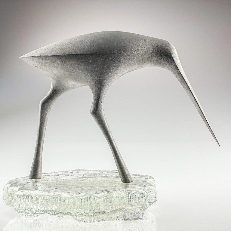 Tapio Wirkkala, Birdsculpture on glass stand, model TW 513, Kultakeskus, ca. 1975  Artist: Tapio Wirkkala (1915 Hanko, Finland-1985 Helsinki, Finland) A giant of Finnish design, Wirkkala was an artist of great diversity for whom no material was