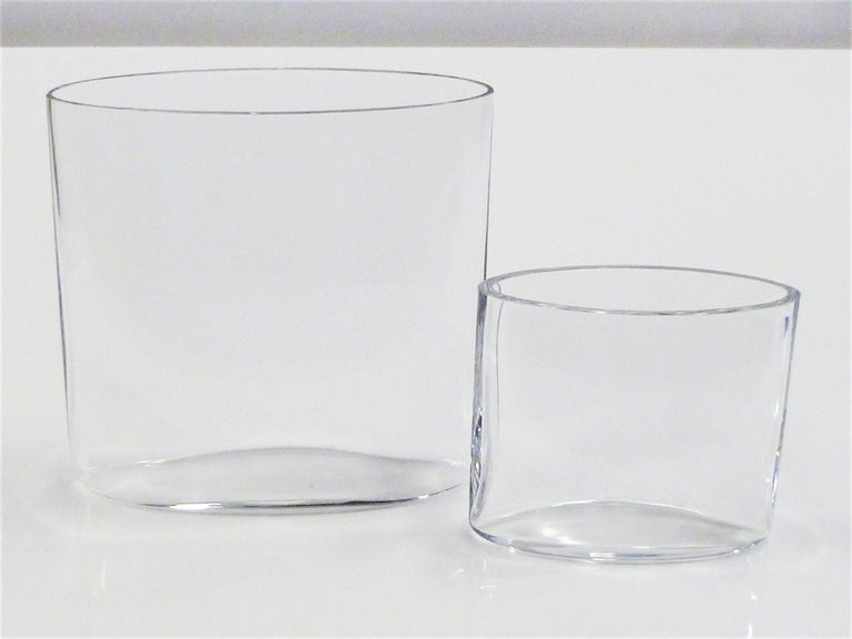 Pair of clear glass Ovalis Vases designed by Tapio Wirkkala (1915-1985) for Iittala, Finland in 1958. These hand blown elliptical shaped vases demonstrate the beautiful optical qualities of such a process. This pair is from the earlier 1958-1966