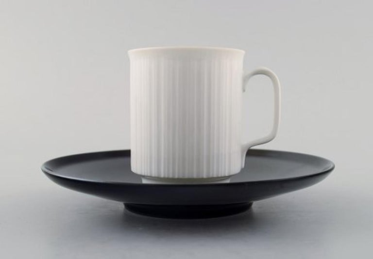 Tapio Wirkkala for Rosenthal Studio-line porcelain noire, ten piece coffee / mocha service in black and white porcelain, modern design, fluted. Designed in 1962. Consisting of ten coffee cups with saucers. The coffee cup measures 6.3 x 5.3 cm. The